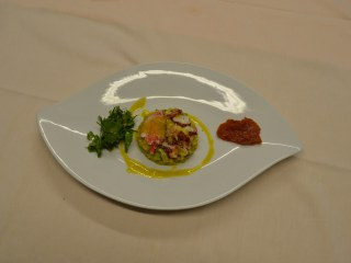 Arlequin de Homard Breton, vinaigrette à la mangue, salade d'herbes potagères