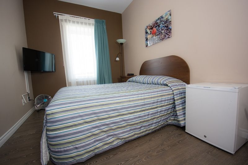 hotel-chapais-chambre-lit-8