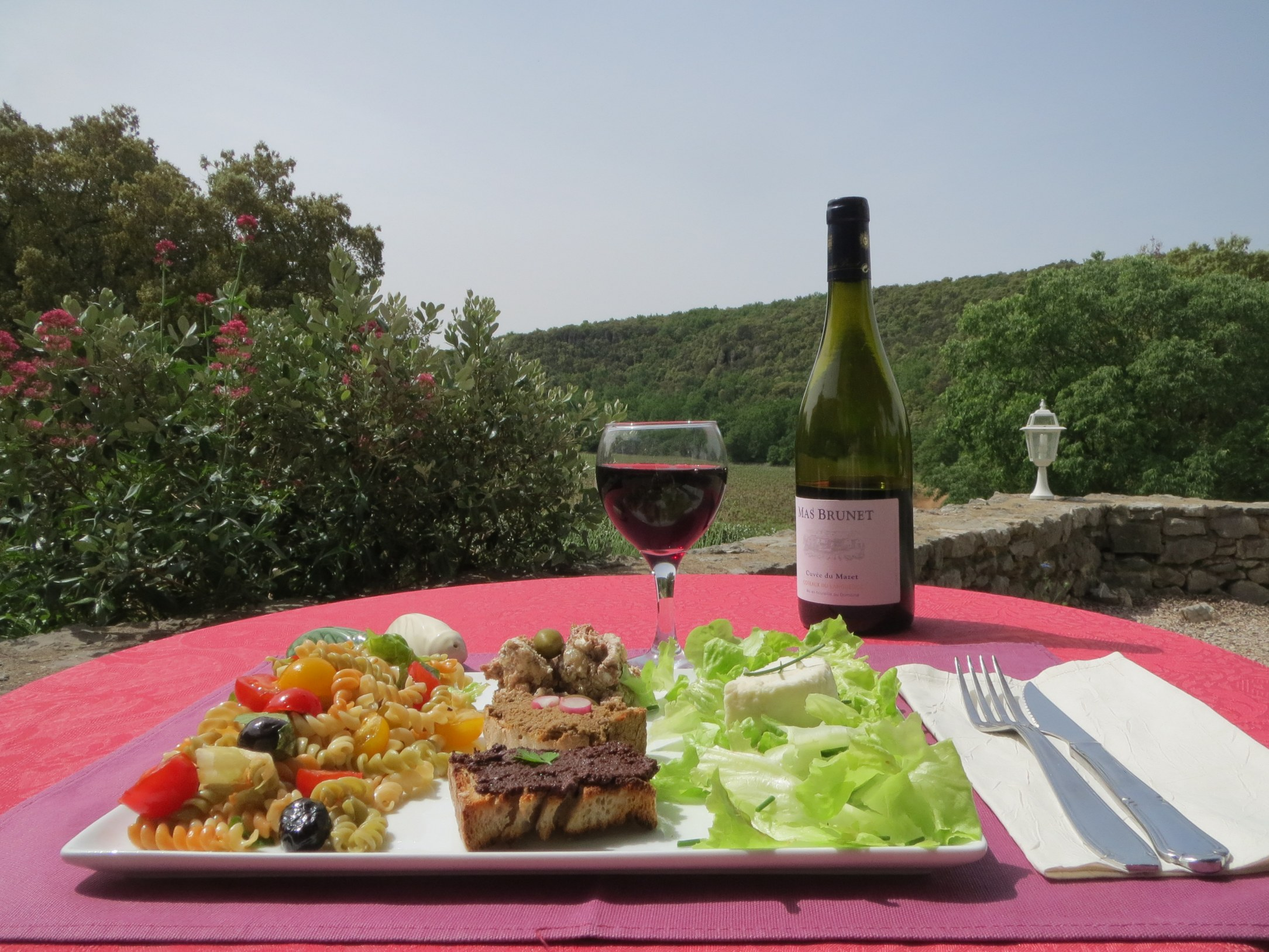 Cold meat, salad and wine