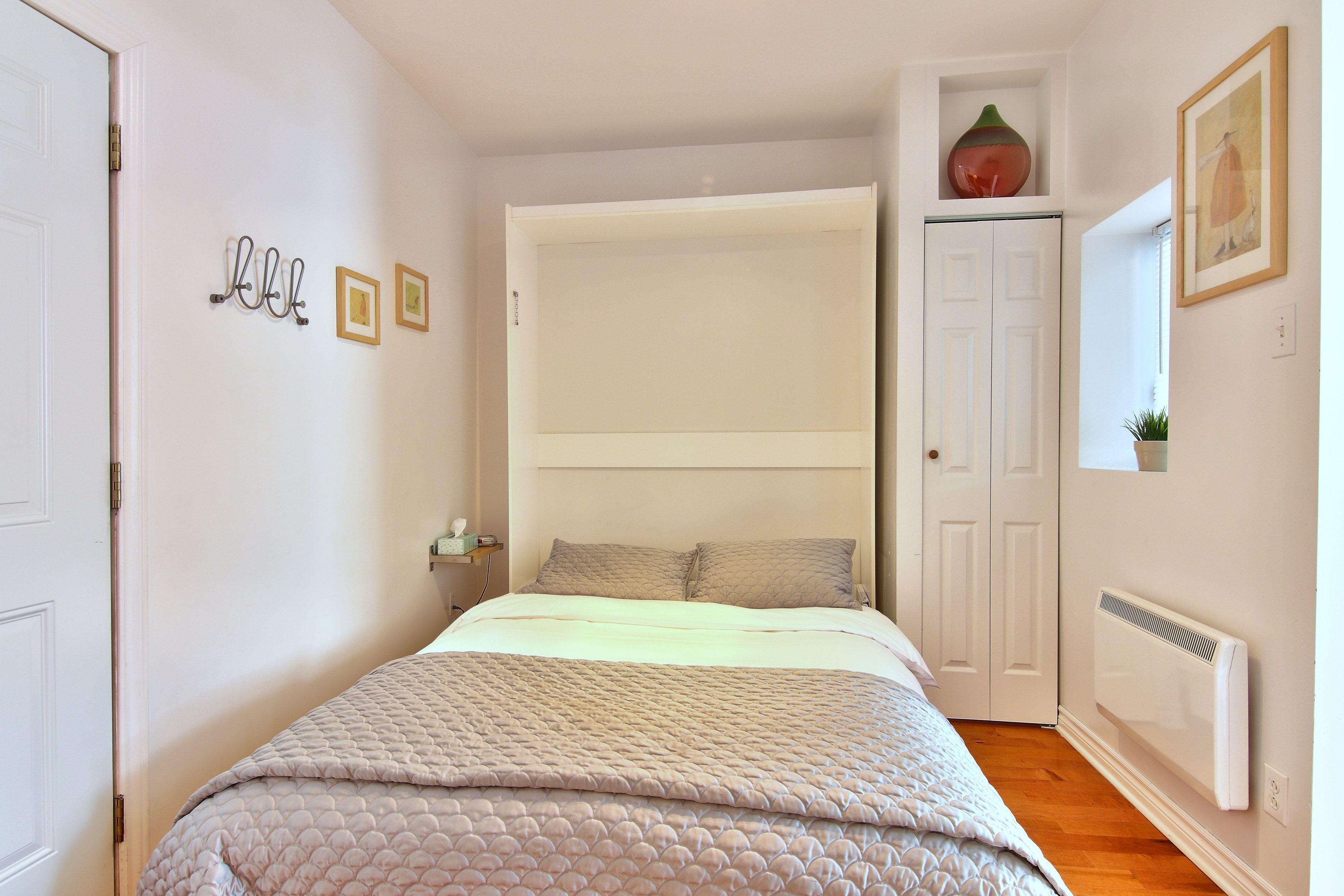 hotel-proche-palais-des-congres-montreal-appartement-vue-jardin-chambre-lit-queen