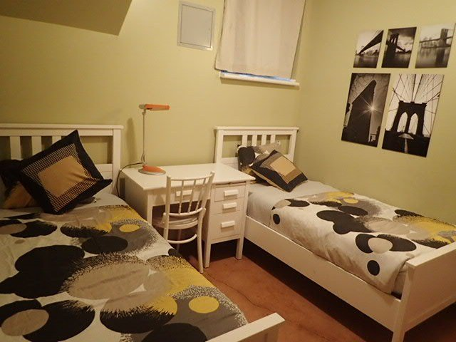 Chambre avec deux lits simples à l'auberge Gîte du plateau Mont-Royal