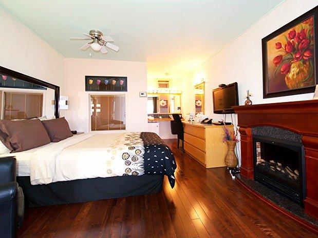 Hotel Chambre Foyer : Chambres un lit queen bain tourbillon double et foyer