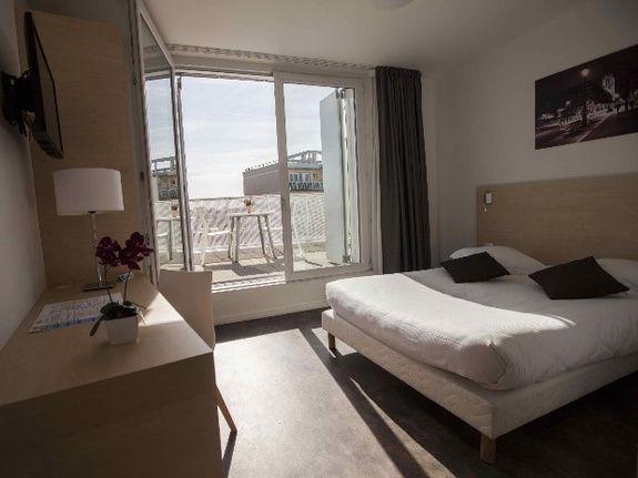 hotel-paris-saint-ouen-chambre-lit-double-studio-balcon
