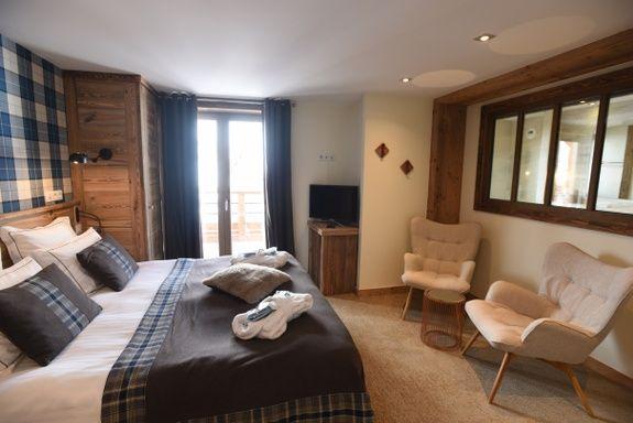hotel-4-étoiles-val-isere-chambre-confort-lit-douillet