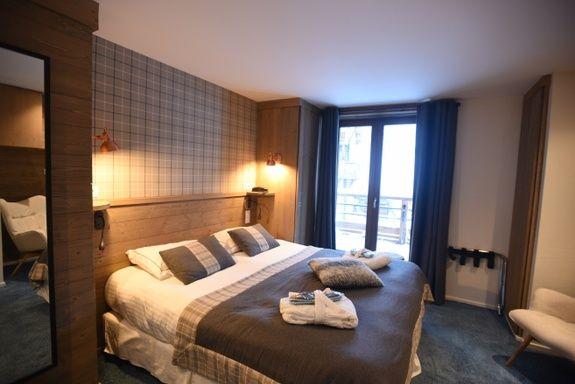 hotel-4-étoiles-val-isere-chambre-confort-lit