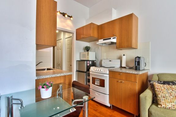 hotel-proche-palais-des-congres-montreal-appartement-1-chambre-cuisine-table-a-manger